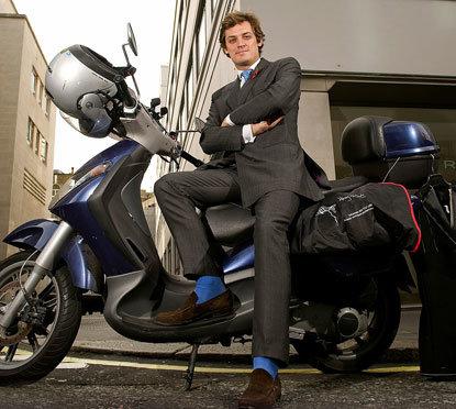 Henry Herbert, scootering bespoke Savile Row Tailor, London.