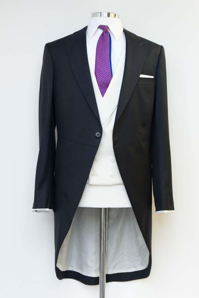 Henry Herbert tail coat on tailoring dummy